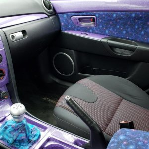 "Avery ""diamond purple"" vinyl wrap on console and door. Galaxy fabric on door and center armrest. Still need to do something with those seats"